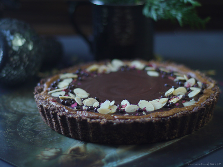 a vegan and grain-free no-bake chocolate pie made with almond butter and apricot jam