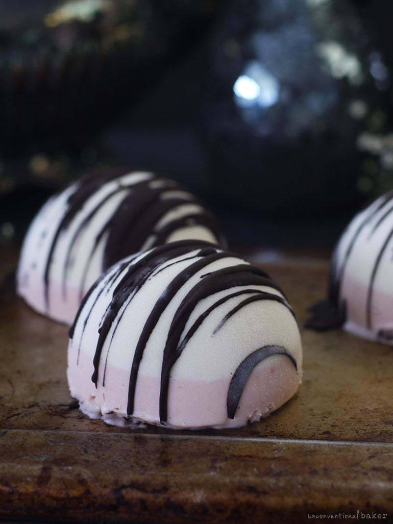 strawberry vanilla chocolate drizzled vegan ice cream bombs