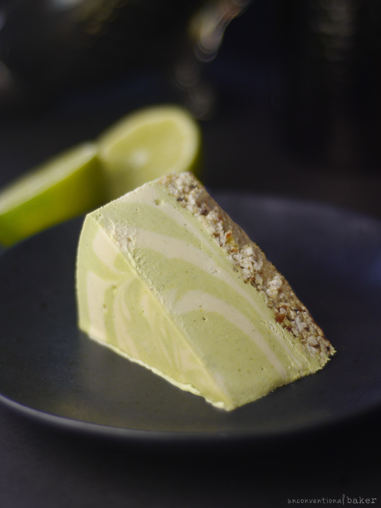 a slice of a grain-free and oil-free raw vegan coconut lime cheesecake