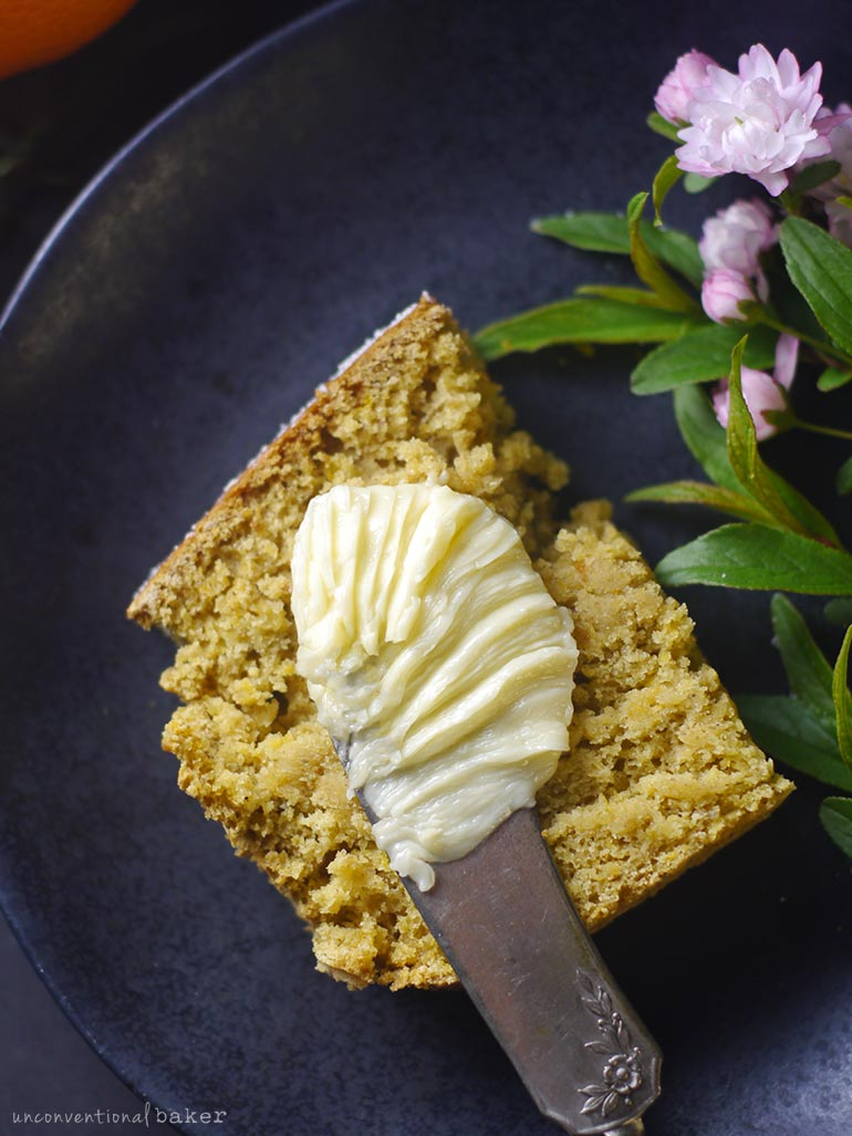 vegan gluten-free slice of tangerine cake with vegan butter