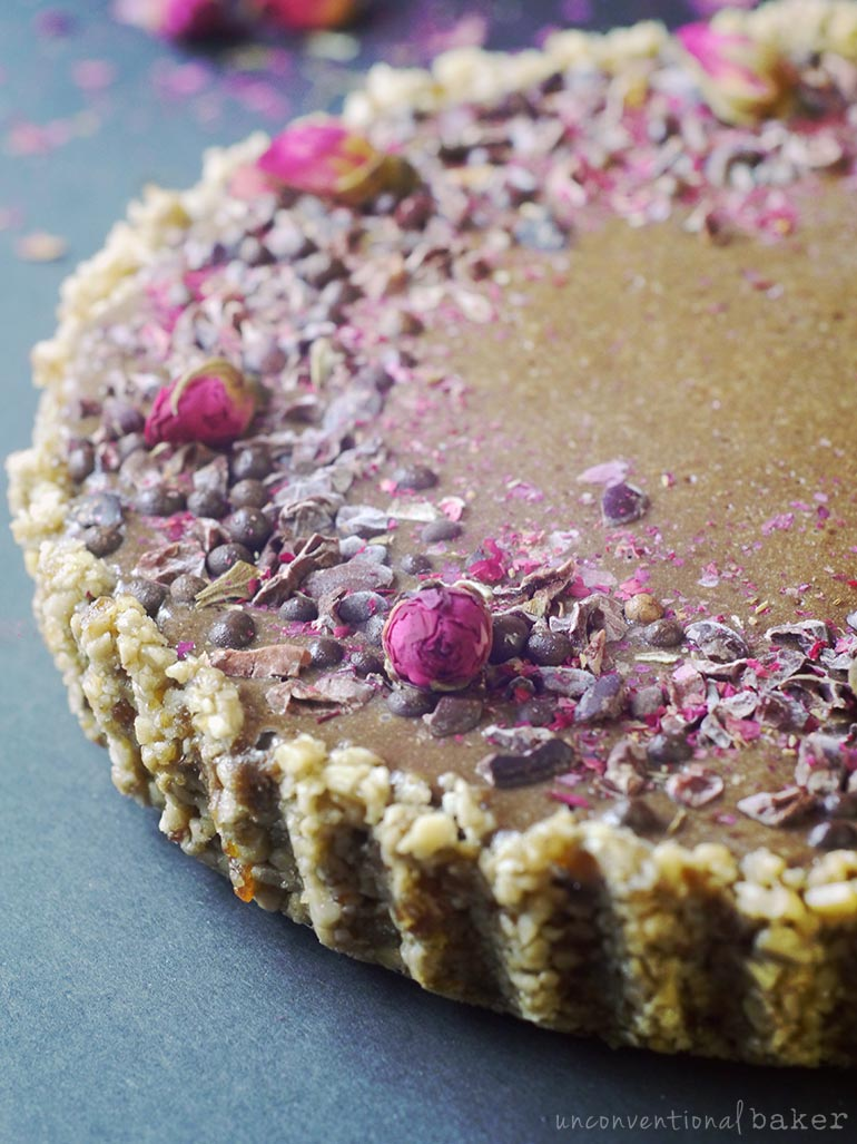 sunflower seed butter chocolate tart with cacao nibs and rose buds